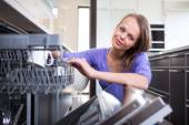 Woman in her modern and well equiped kitchen — Stock Photo