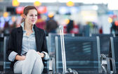 Female passenger at the airport — Stock Photo
