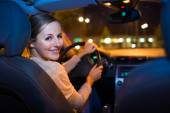 Woman driving her new car at night — Stock Photo