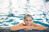 Female swimmer in an indoor swimming pool — Stock fotografie