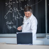Senior chemistry professor at lecture — Stock Photo