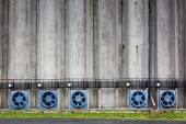 Concrete wall of a cereal silo tower with vents — Stock Photo