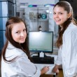Two young researchers carrying out experiments in a lab — Stock Photo #67950681