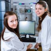 Two young researchers carrying out experiments in a lab — Stock Photo