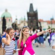 Young women sightseeing in Prague historic center — Stockfoto #69974381