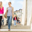 Young women sightseeing in Prague historic center — Foto de Stock   #69974389