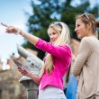 Young women sightseeing in Prague historic center — Foto de Stock   #69974397