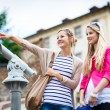 Young women sightseeing in Prague historic center — Foto de Stock   #69974399