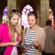 Young women sightseeing in Prague historic center — Stockfoto #69974401