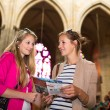 Young women sightseeing in Prague historic center — Stockfoto #69974403