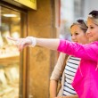 Young women window shopping in a city — Stock Photo #69974405