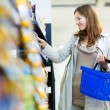 Woman shopping in a grocery store — Stock Photo #69974795