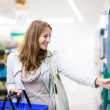 Woman shopping in a grocery store — Stock Photo #69974811