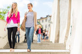 Young women sightseeing in Prague historic center — Stock Photo