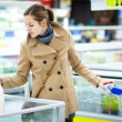 Woman buying groceries in a supermarket — Stock Photo #71058057