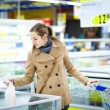 Woman buying groceries in a supermarket — Stock Photo #71058059