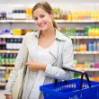 Woman buying groceries in a supermarket — Stock Photo #73295295