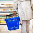 Woman buying groceries in a supermarket — Stock Photo #73295305