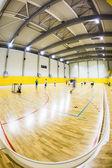 Modern multifunctional gymnasium with young people — Stock Photo
