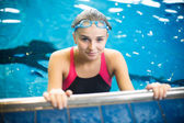 Female swimmer in an indoor swimming pool — Stock Photo