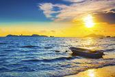 Boat on a sea coast at sunset — Stock Photo