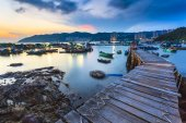 Sunset at fishing village wooden bridge — Stock Photo