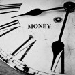 Money black and white clock face. — Stock Photo #55091917