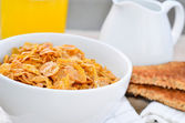 Breakfast cereal with toast and juice. — Stock Photo