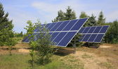 Two photovoltaic panels set in backyard — Stock Photo
