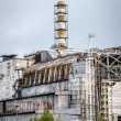 Chernobyl Nuclear Power Plant sarcophagus — Stock Photo #63592379