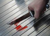 Hand with bloody knife — Stock Photo