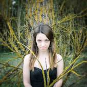 Young sensual woman in wood harmony with nature — Stock Photo