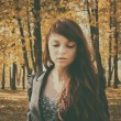 Beautiful woman with red hair in autumn park — Stock Photo #56703341