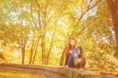 Woman with freckles and red long hair in fall park — Stock Photo