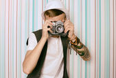 Young guy photographer hipster — Stock Photo