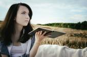 Young unusual girl illustrates conceptual idea with book — Stock Photo