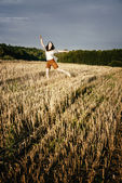 Young beautiful free happy woman jumps happy with smile — Stock Photo