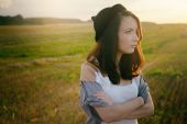 Young alonel free sad woman hipster in fall field  — Stock Photo