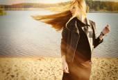 Beautiful woman long red hair on wind near lake develop — Stock Photo