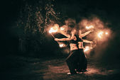 Active girls carries out tricks for fire show at night — Zdjęcie stockowe