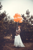 Unusual woman with balloons as concept outdoors — Стоковое фото