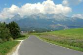 Road, mountains and clouds in Slovakia. — Stock Photo