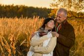 Couple in love embracing in autumn sunset — Foto Stock