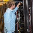 IT specialist working in datacenter — Stock Photo #80021598