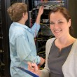 Two network engineers in server room — Stock Photo #80021994
