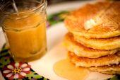 Waffles with honey syrup — Stock Photo
