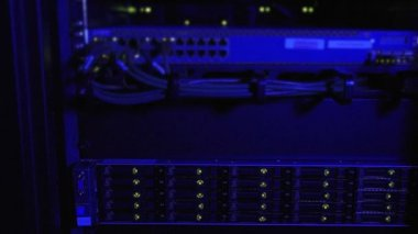 Blue lighting on rack of internet servers — Stock Video