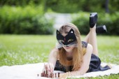 Woman  with mask adjust wooden chess pieces — Stok fotoğraf