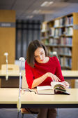 Woman in library found something very interesting — Stock Photo