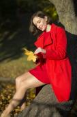 Woman at park sets of maple leaves — Photo